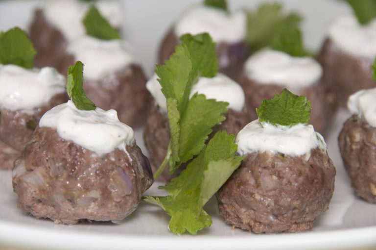 Ground lamb meatballs are with cumin, cilantro and mint and served with a traditional Tzatziki yogurt sauce. Makes for a fancy appetizer for a cocktail party.