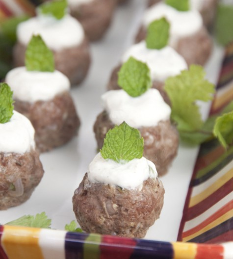 These lamb meatballs are spiced up with cumin, cilantro and mint and served with a traditional Greek yogurt sauce. Makes for a fancy appetizer for a cocktail party.
