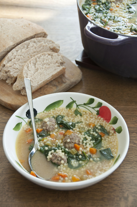 Tiny meatballs made of ground beef, veal and pork with fresh vegetables to make an easy lunch or dinner soup meal.
