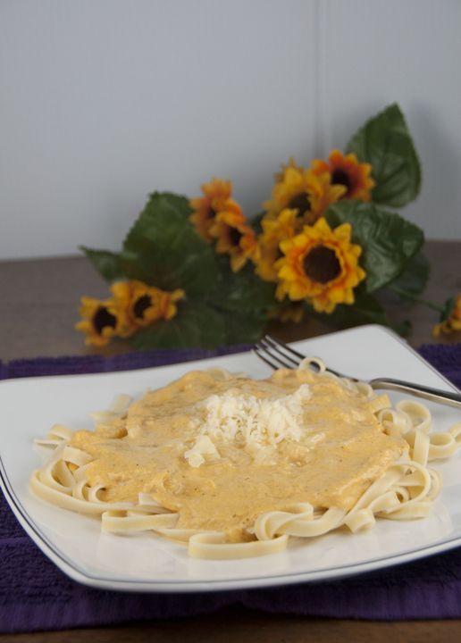 Homemade Cheesy and Creamy Pumpkin Alfredo Sauce served over pasta makes the perfect fall dish your whole family will love.