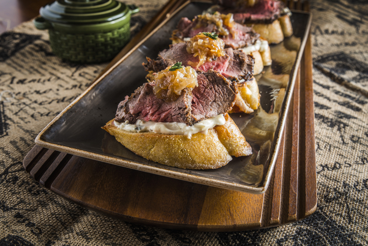 Mouthwatering Holiday Steak Bruschetta made with beef tenderloin, sourdough bread, and a seasonal thyme mayo with caramelized shallots on top.  This is a holiday appetizer recipe to really impress your guests!