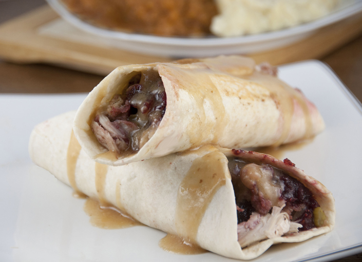 This copy-cat Earl of Sandwich recipe piled high with slow roasted turkey, stuffing, gravy and cranberry sauce, will put your Thanksgiving leftovers to good use.