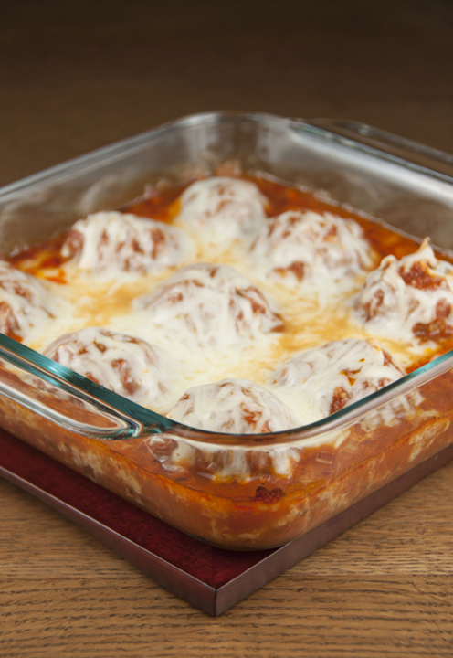 A twist on chicken parmesan in the form of cheese meatballs with tomato sauce made in the oven. Easy but special enough to serve for a special occasion or dinner guests.