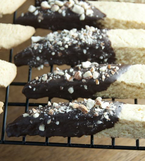 Chocolate Almond Biscotti are twice-baked Italian cookies paired with orange zest, toasted almonds and melted, smooth chocolate. Absolutely delicious for the holidays or any occasion.