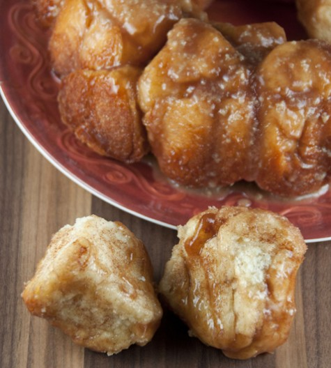 An easy recipe for cinnamon monkey bread. This ooey-gooey bread has cinnamon and is drizzled with a warm maple glaze.