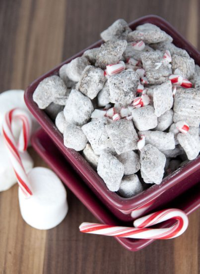Puppy Chow muddy buddies made with Rice Chex, hot chocolate mix, and melted chocolate for an easy Christmas or cold weather snack!
