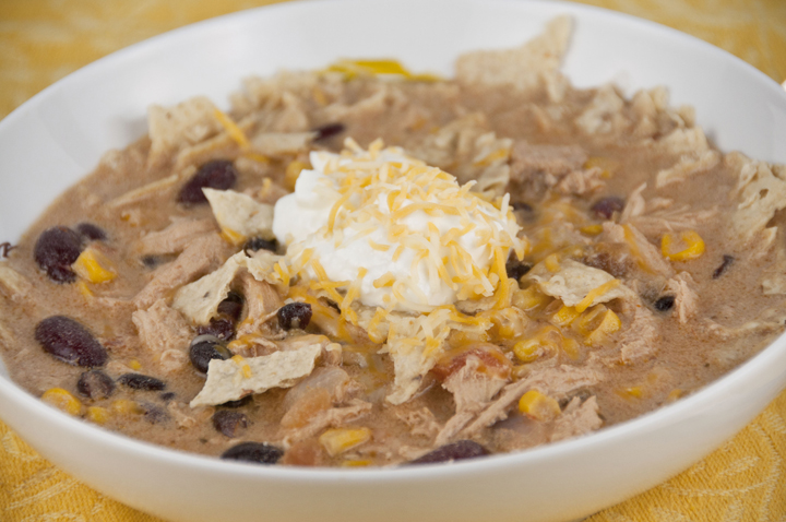 This no-fuss Chicken Tortilla Soup is quick to make, incredibly flavorful, and filling and garnished with crushed corn tortilla chips!