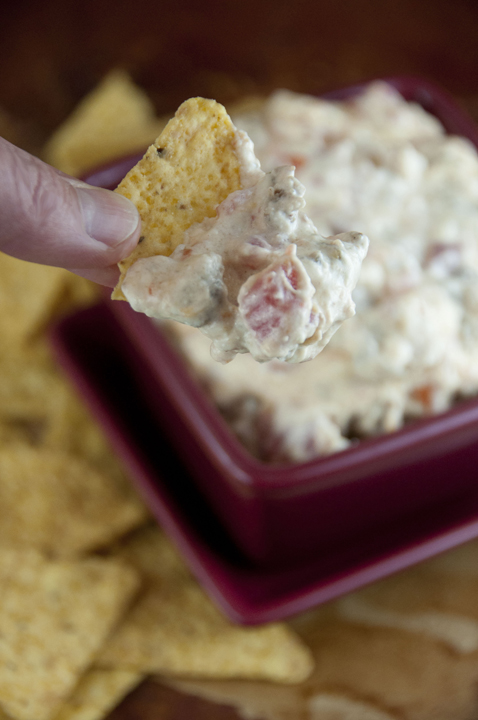 Cheesy sausage dip cooked right in the crock pot for an easy appetizer for football season, holidays, pot lucks, or tailgating parties!