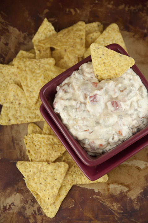 Rotel Cheese sausage dip cooked right in the slow cooker for an easy appetizer for football season, holidays, pot lucks, or tailgating parties!