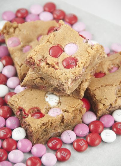 Brown Sugar M&M Blondies are an easy dessert to make for Valentine's day or any occasion. They are, soft, chewy and full of flavor!