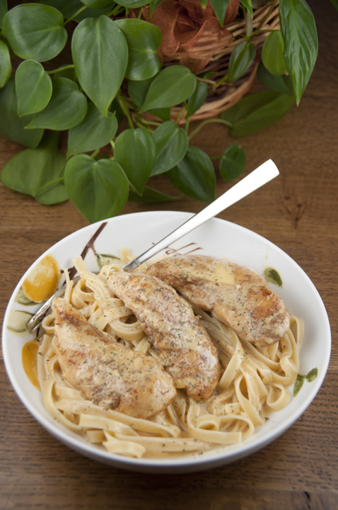 Chicken Lazone is a creamy, low carb New Orleans dish that is delicious served on it's own.  You can serve it over pasta or mashed potatoes for a more filling meal.