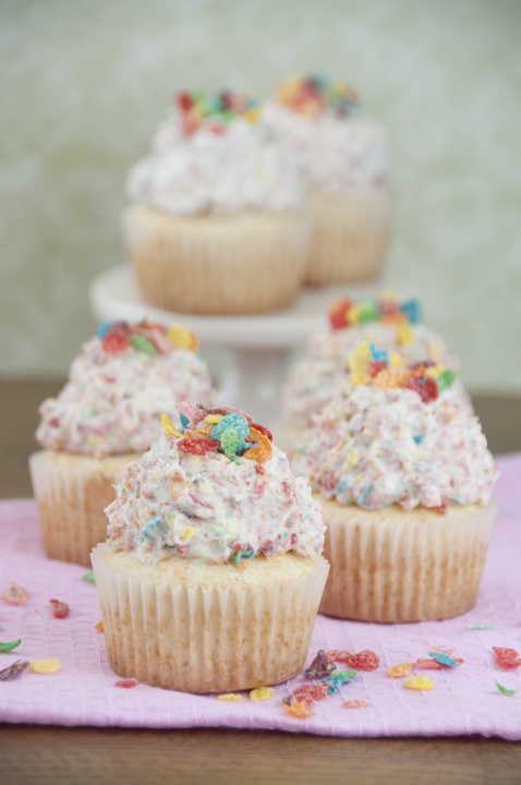 A simple vanilla cupcake recipe topped with Fruity Pebbles Buttercream Frosting perfect for St. Patrick's Day dessert. These are not overly sweet and kids would love them!