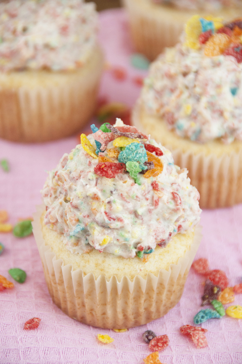Easy vanilla cupcake recipe topped with Fruity Pebbles Buttercream Frosting perfect for St. Patrick's Day dessert.