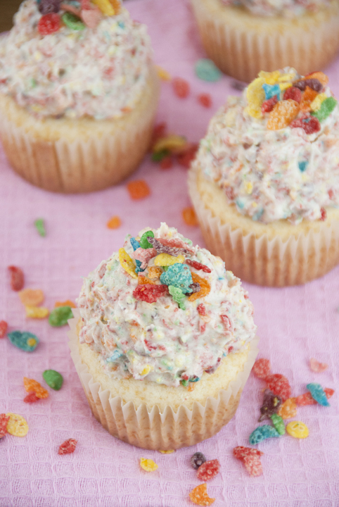 Vanilla Cupcakes with Fruity Pebbles Buttercream Icing.
