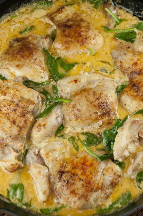 Simple chicken skillet dinner recipe idea for chicken thighs and creamy lemon butter sauce.