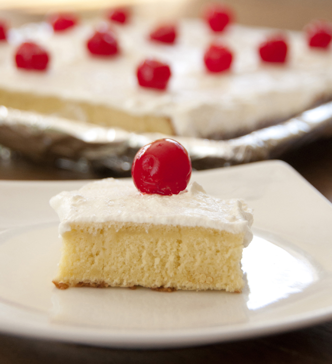 Tres Leches cake is a great Mexican dessert made with three kinds of milk for Cinco de Mayo or any special occasion and topped with cherries.
