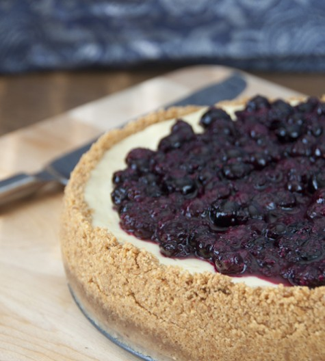 Creamy New York-Style Blueberry Cheesecake recipe with a buttery, thick graham cracker crust and sweet fruit topping. Guests will be begging for seconds!