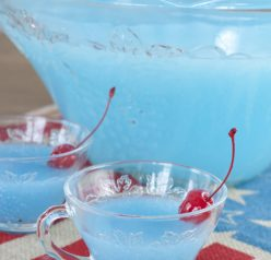 Delicious Blue Piña Colada Party Punch that is kid-friendly and perfect for 4th of July, a baby shower, or summer birthday parties!