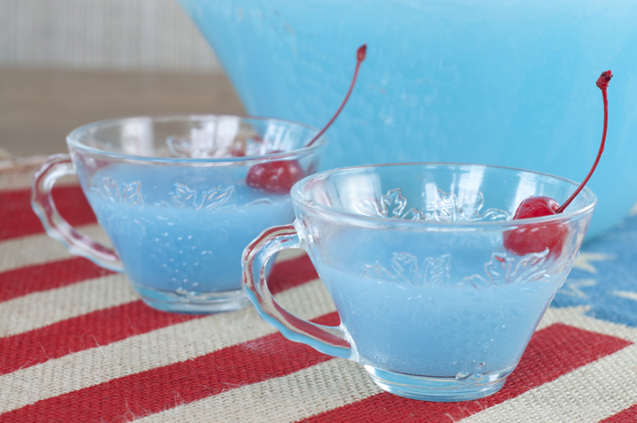 Super Easy Blue Piña Colada Party Punch recipe that is non-alcoholic and perfect for fourth of July, a baby shower, or Frozen and Little mermaid birthday parties!
