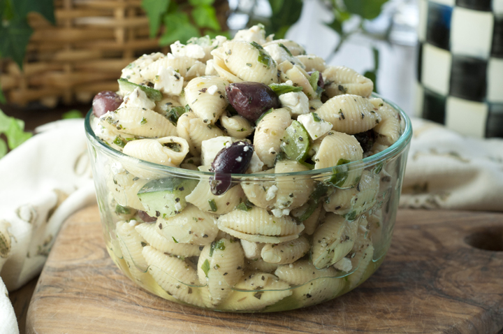 This recipe for Greek Pasta Salad has all of the simple flavors of a classic Greek salad with cucumber, olives, and crumbled feta cheese. Great side dish for any summer BBQ, holiday, or picnic.