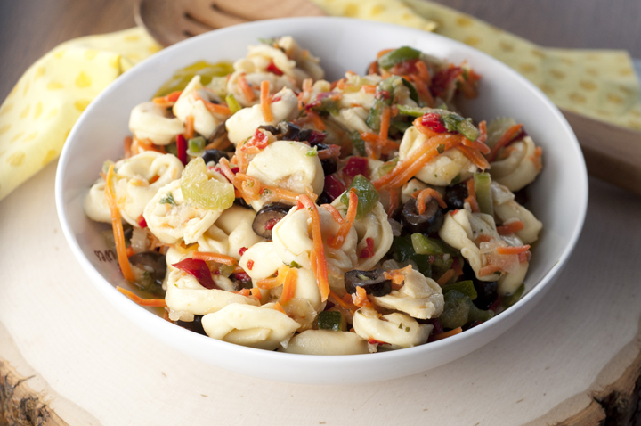 Cheese Tortellini Pasta Salad with Honey Vinaigrette can serve as an Italian antipasto or side dish for summer.