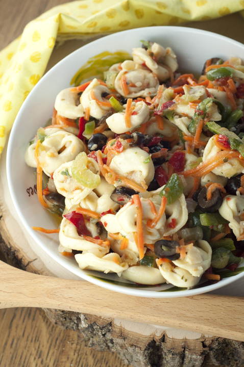 An easy and delicious cold Cheese Tortellini Pasta Salad with Honey Vinaigrette tastes like an Italian antipasto platter and is loaded with veggies for a great side dish recipe.