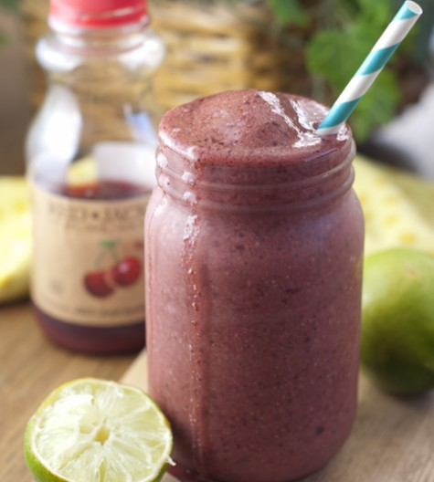 Creamy, refreshing, and made with fresh cherry juice, this Cherry Coconut Lime Smoothie recipe will hit the spot any day of the year!