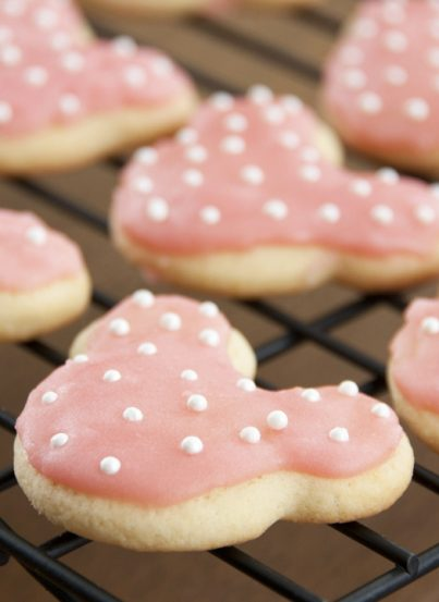 These cute Minnie Mouse sugar cookies are the easiest and the best-tasting sugar cookie recipe - great for a child's Disney themed birthday party! Frost them any way you like, but these will be your new go-to cut-out cookie!