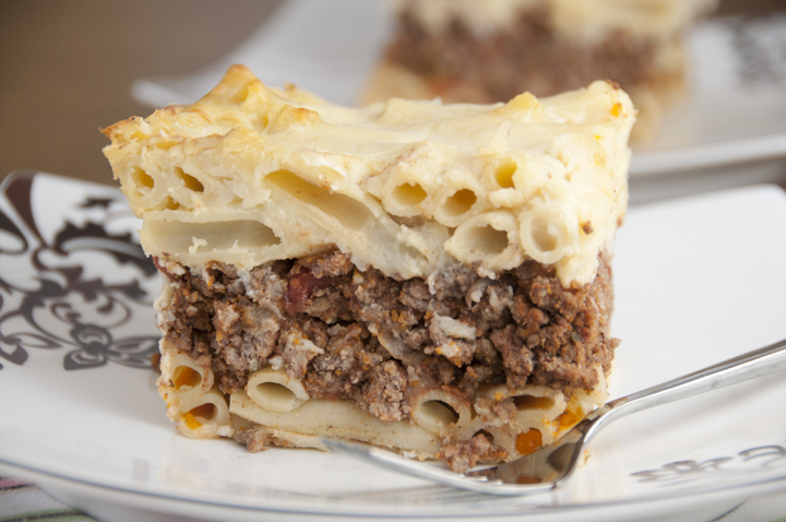 Layers of comfort food are baked to perfection in this Pastitsio (or Greek Pasta Bake) with layers of seasoned ground beef, creamy Bechamel sauce, and pasta. This is one of my very favorite meals!