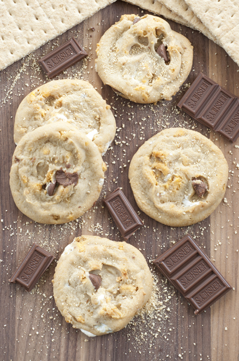Soft-baked peanut butter s'mores cookies loaded with melted marshmallow and chocolate. No need for a campfire - bring your summer s'mores inside!