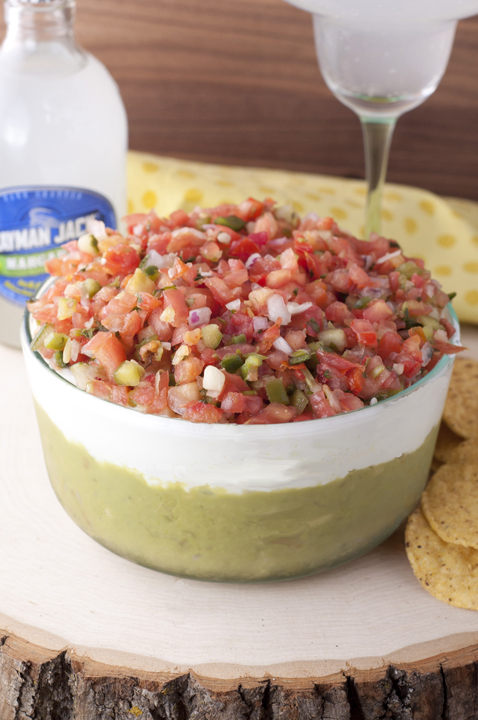 Loaded with guacamole, cheese, sour cream, and Pico de Gallo, this Triple Layer Mexican Party Dip is a fun way to enjoy your next party or picnic!!