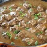 Authentic tasting recipe for Swedish Meatballs with Creamy Gravy made with ground beef, pork, and veal that your whole family will go crazy for!