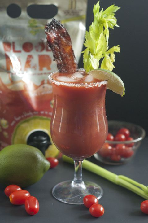 Recipe for a refreshing, spicy Candied Bacon Bloody Mary is the perfect accompaniment to any breakfast or brunch favorites and is great to serve at a football party!