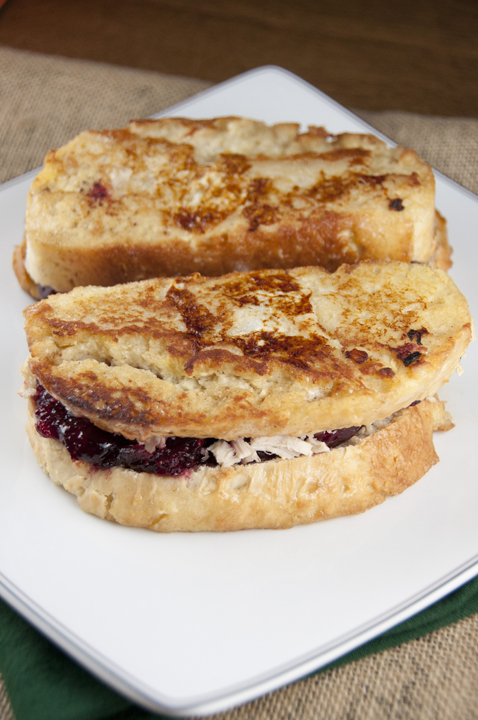 Leftover Turkey-Cranberry Monte Cristo Sandwich is the perfect way to use those Thanksgiving turkey leftovers for breakfast, lunch, or dinner.  Your house guests will go crazy for these sandwiches!