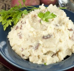 A hands-off recipe for herb Slow Cooker Buttery Garlic Mashed Potatoes making for an easy, stress-free side dish for Thanksgiving and all of the holidays.