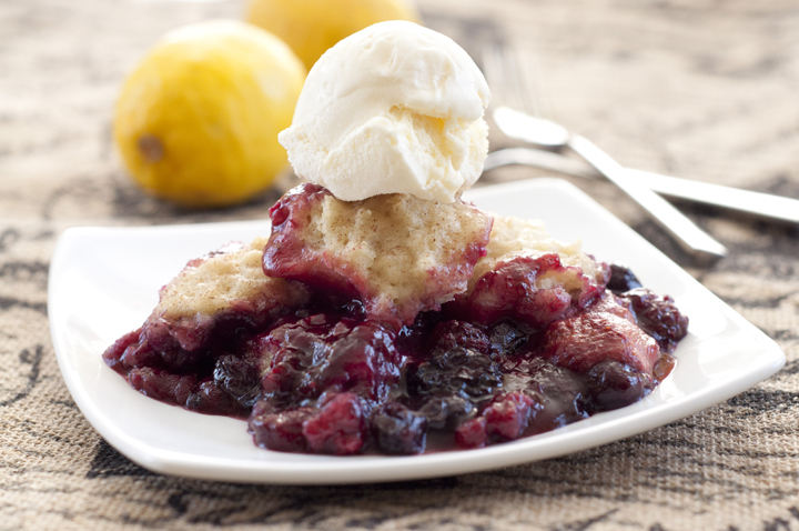 Slow Cooker Mixed Berry Cobbler recipe is a quick and easy dessert for the holidays and creates a deeply flavorful cobbler with very little prep time!