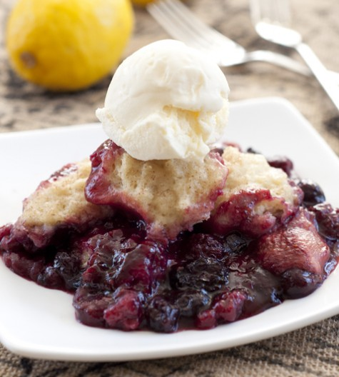 Crock Pot Mixed Berry Cobbler recipe is perfect for the holidays and creates a deeply flavorful dessert with very little prep time!