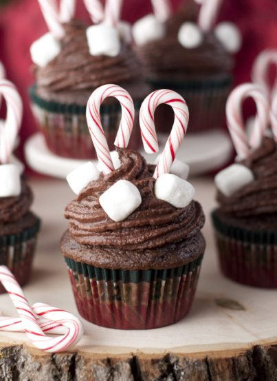Chocolate Cupcakes and Hot Chocolate Buttercream frosting recipe are chocolate treats topped with fluffy, hot chocolate frosting and mini marshmallows that are perfect for Christmas! You'll love these decadent cupcakes that taste just like a warm cup of hot cocoa.