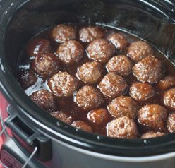 Crock Pot Grape Jelly BBQ Cocktail Meatballs are an awesome recipe for holiday entertaining, Super Bowl party, or pot luck made right in the slow cooker. They are so simple to make and extremely crowd-pleasing!
