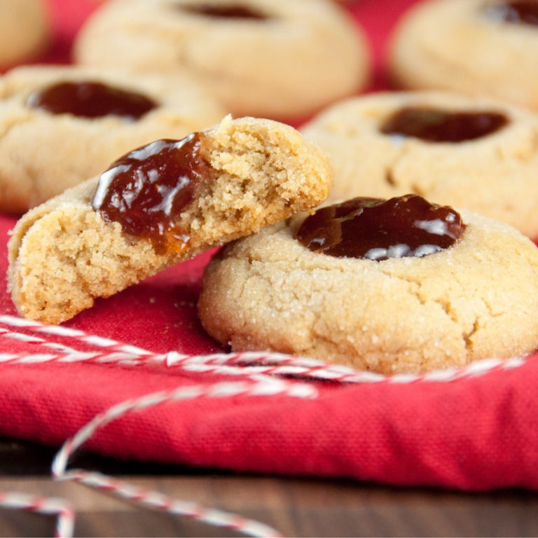 Peanut Butter and Jelly Thumbprint Cookies your favorite childhood snack turned into a Christmas cookie!