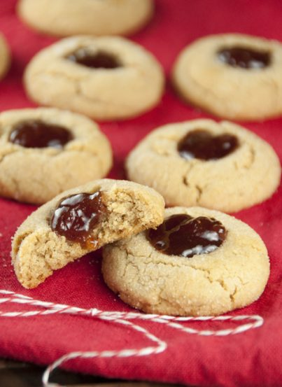 Peanut Butter and Jelly Thumbprint Cookies are all of the goodness of a PB&J sandwich in a beloved melt-in-your-mouth, easy Christmas cookie recipe!