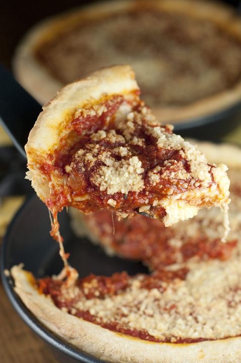 Authentic recipe for Chicago-Style Deep Dish Pizza with a thick, buttery crust, sweet homemade tomato sauce, and plenty of mozzarella cheese!