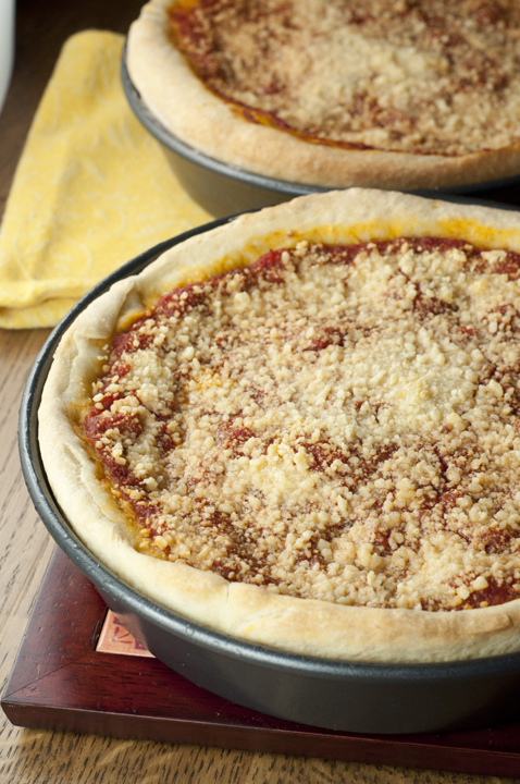 Authentic recipe for Chicago-Style Deep Dish Pizza made just like you would have in Chicago with a thick, buttery crust, homemade tomato sauce, and loaded with cheese!