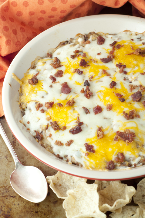 Cheesy Bacon Cheeseburger Dip is the perfect game day dip recipe that has all of your favorite flavors of a bacon double cheeseburger turned into an addicting hot dip!