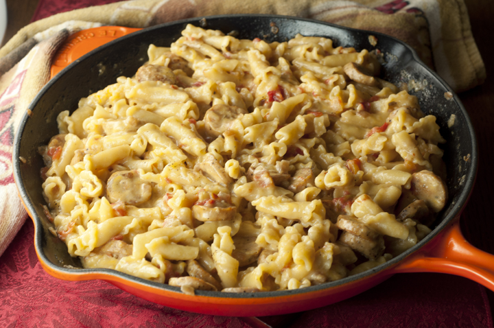 Cheesy Chicken Sausage Pasta Skillet recipe is a one pot meal that the whole family will love and takes less than 30 minutes to cook!