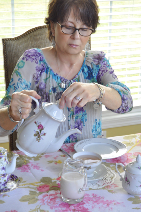 Pouring the tea out of a vintage tea pot for an adult afternoon tea party.