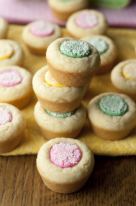 Mini Melty Mint Sugar Cookie Cups dessert recipe are chewy, buttery cookie cups with a melty mint in the middle that are great for spring, baby showers, Easter, and more.