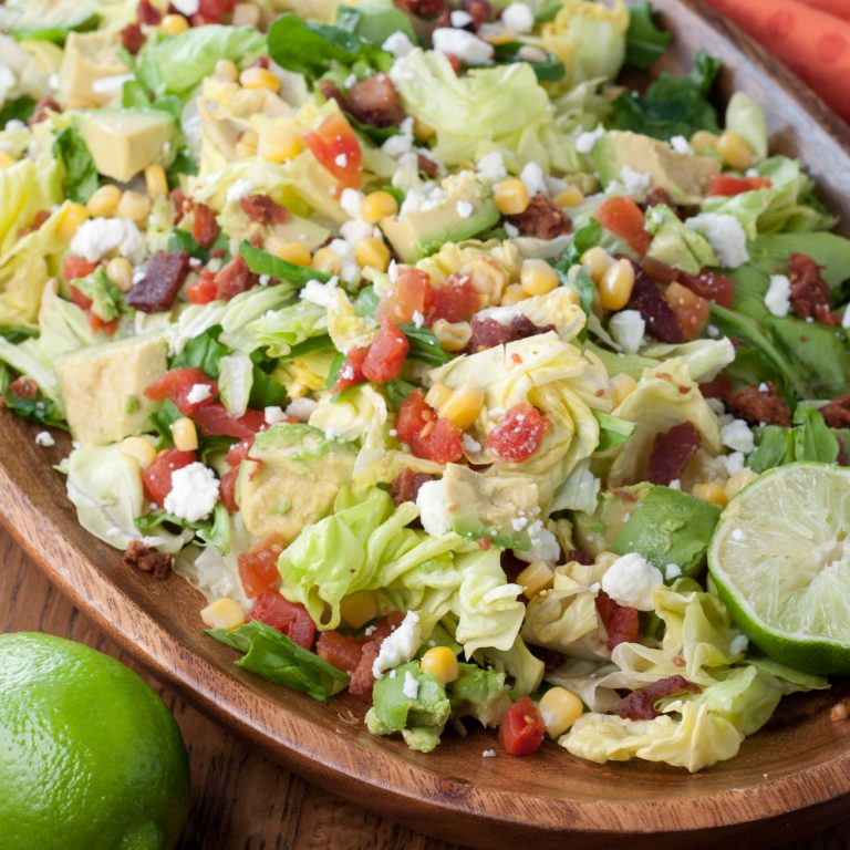 Your favorite classic sandwich turned into a healthy BLT Chopped Salad and Avocado recipe and finished off with a sweet lime vinaigrette!