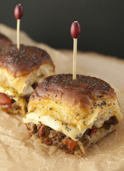 """Jalapeño Cheeseburger Party Buns recipe, also knows as """"sliders"""", is a mouth-watering way to feed a crowd quickly and easily with seasoned beef, gooey cheese, and a sweet glaze!"""