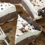 No-Bake Cinnamon French Silk Pie (or chocolate pie) recipe uses a homemade graham cracker crust OR ready-made pie crust, rich chocolate filling, sturdy, homemade whipped cream, and fancy chocolate curls for a beautiful presentation.